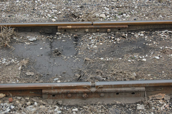 Two railroad track joint bars side-by-side.