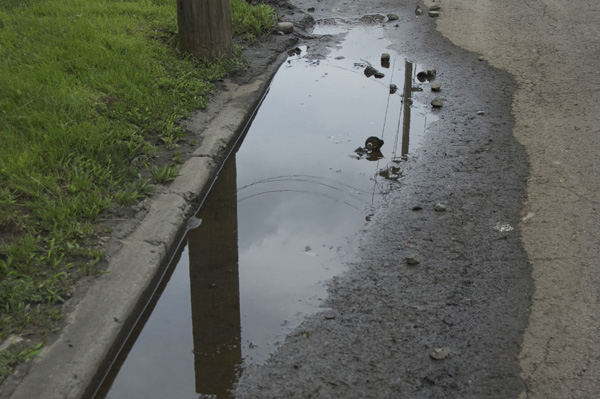 Mundane, ordinary and boring, rain puddle_000